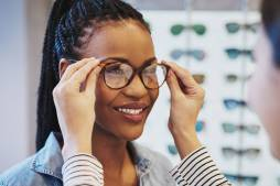 African American Woman Trying on Glasses