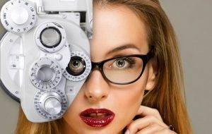 advertisement for eye care in cypress, tx with close up on blonde woman with red lips looking through eye exam technology while wearing eyeglasses